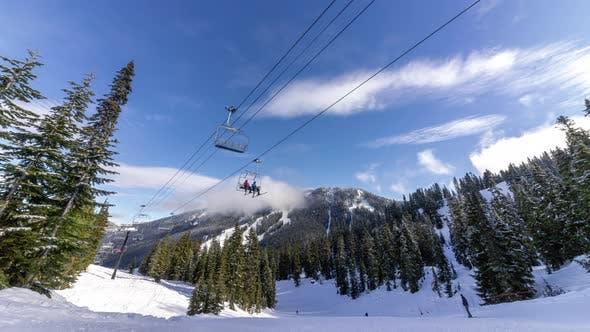 Thumbnail for Blue Sky Timelapse Under Chairlift At Popular Ski And Snowboard Resort