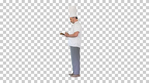 Male chef cook making notes, Alpha Channel