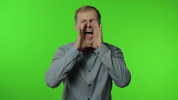 Thumbnail for Expressive Man Screaming and Shouting. Studio Portrait of Handsome Person on Chroma Key