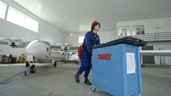 Thumbnail for Professional Female Mechanic Working in Aircraft Hangar