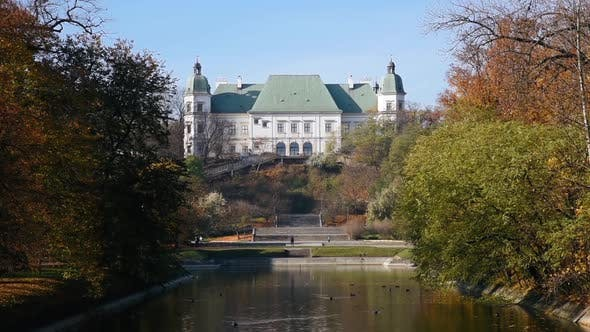 Thumbnail for City park Royal Lazienki with pond and Ujazdowski Castle on background at autumn