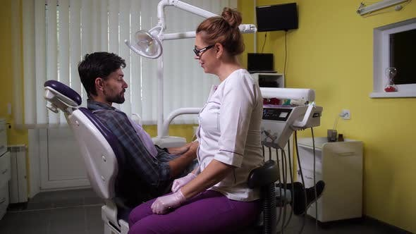 Thumbnail for Satisfied Patient Giving Thanks To Dentist