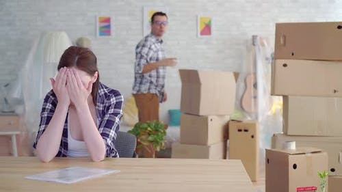 Woman and Man Breakup or Divorce Moving Boxes