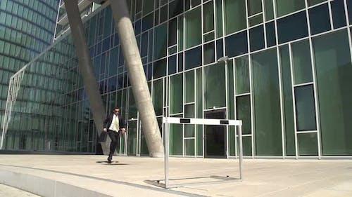 Slow Motion Business Hurdler Office Block