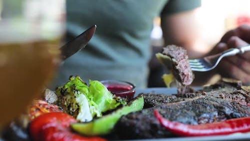 Eating Food Closeup, Man Dipping Meat Steak Piece In Sauce