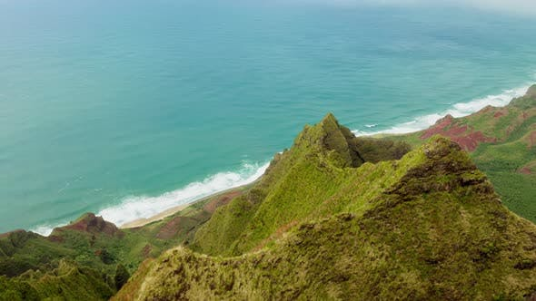 Thumbnail for Aerial View Over Impressive Steep Mountain Precipice of Triangular Shape at the Hawaiian Coast