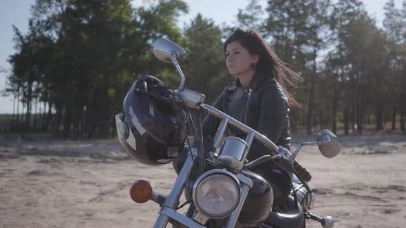 Thumbnail for Pretty Caucasian Girl Sitting on the Motorcycle Looking Away
