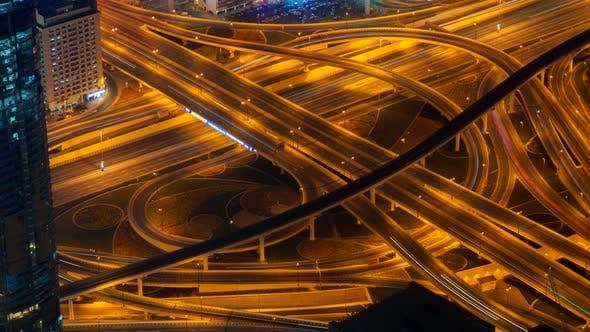 Night Dubai Traffic Junction Time Lapse. Pan Up