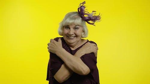 Kind-hearted Senior Woman Showing Beckoning Gesture, Embracing. Elderly Stylish Grandma Wants To Hug