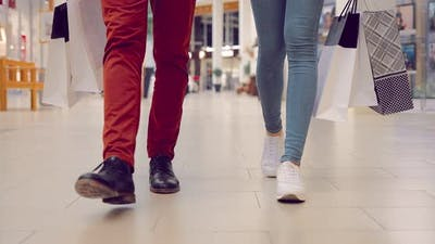 Closeup of a Couple Walking Feet in a Mall