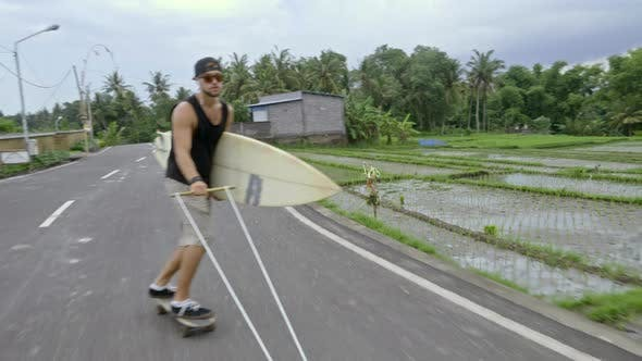 Skateboarder Skitching with Surfboard