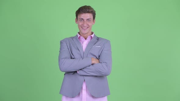 Thumbnail for Happy Young Businessman Smiling with Arms Crossed