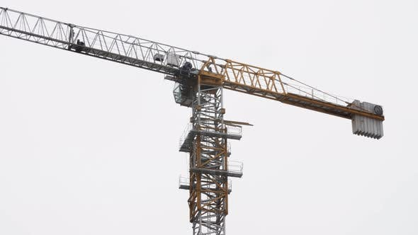 Cover Image for Tower Crane Working on Construction Site Cloudy Day Clear Sky on Background