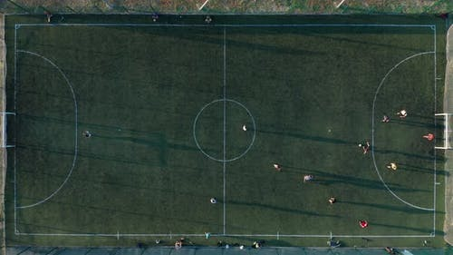 Aerial Shot Two Teams Playing Ball in Football Outdoors, Top View, Football Game Outdoors, Green