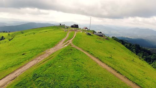 Aerial View Mountain Vysokyi Verkh in the Ukrainian Carpathians Is Covered with Green Grass in