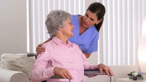 Senior caregiver checking up on patient
