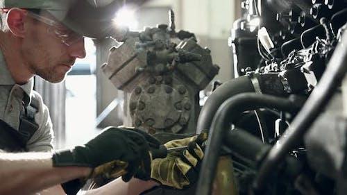 Semi Truck Mechanic Fixing Vehicle Engine