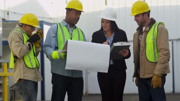 Thumbnail for Commercial construction crew look over plans
