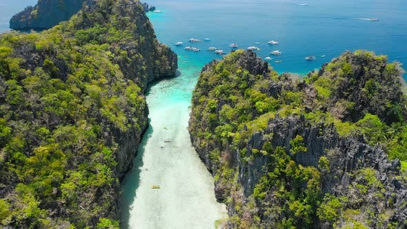 Thumbnail for Big Lagoon, El Nido, Palawan, Philippines, Drone Aerial Fly Between Limestone Cliffs Above Shallow