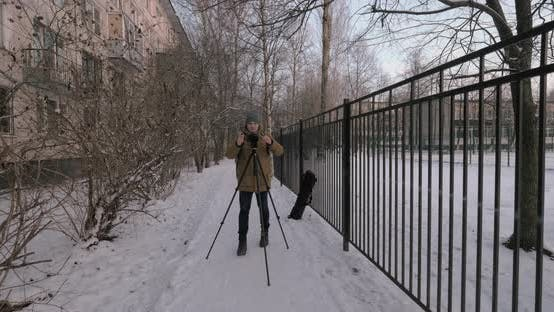 Thumbnail for Man Photographer Taking Shots Outdoor in Winter