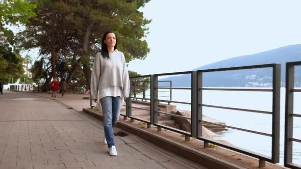 Thumbnail for Caucasian Brunette Walking on the Seacoast