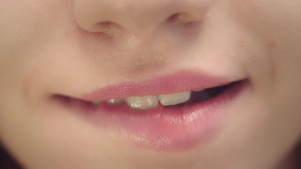 Thumbnail for Female Face with Smiling Mouth Biting Plump Lips