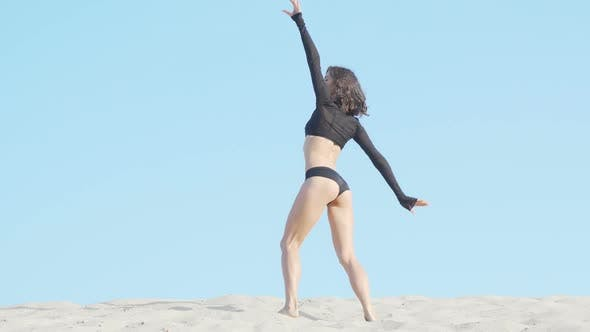 Thumbnail for Beautiful Flexible Female Dancer Performing on Sand in the Desert