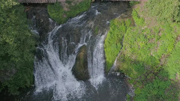 Thumbnail for River flowing into waterfalls
