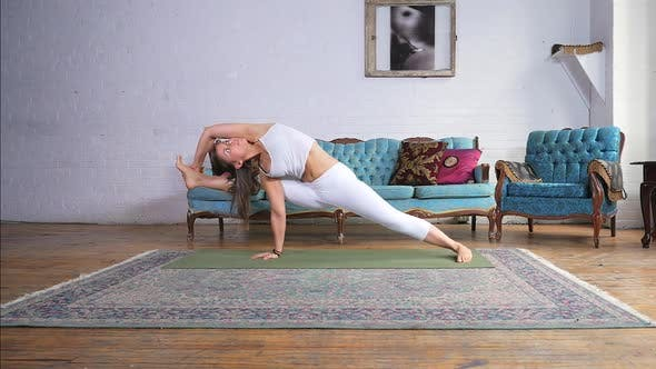 Thumbnail for Young Attractive Female Doing The Vizvamitras Pose On A Yoga Mat
