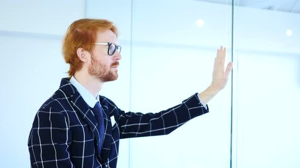 Thumbnail for Redhead Businessman Looking through Office