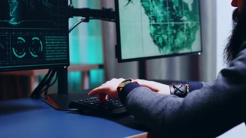 Close Up of Cyber Criminal Hands Writing Malware