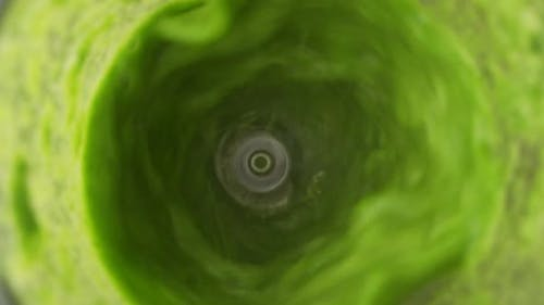Slow Motion Green Fresh Smoothie in Blender Top View
