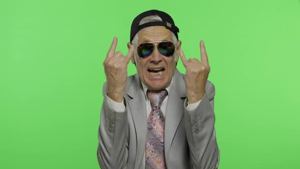 Thumbnail for Funny Senior Businessman in Sunglasses Show Sign of the Horns with His Hands
