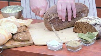 Cutting crusty bread with a knife