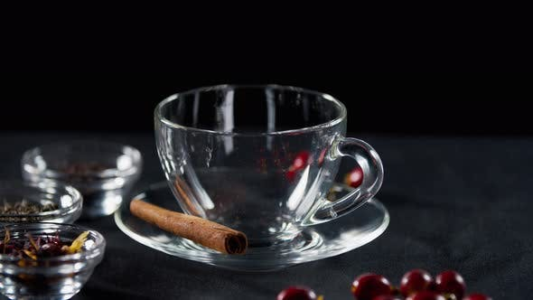 Close Up of a Cup with Cinnamon and Dry Tea on the Side, Teapot,