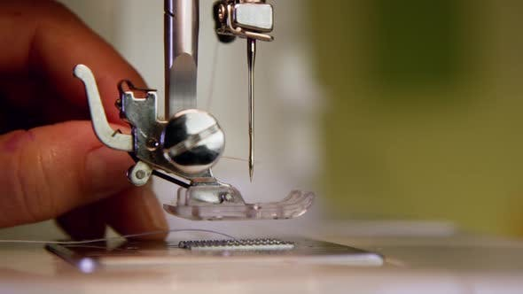 Thumbnail for Threading The Needle In A Sewing Machine 32