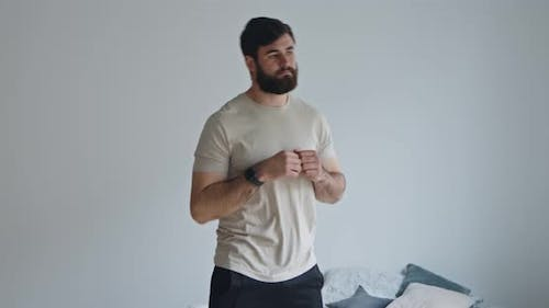 Young Bearded Guy Exercising Tilts, Active Lifestyle Concept