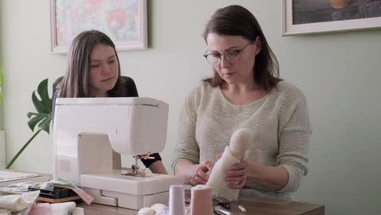 Thumbnail for Mom Teaching Daughter Sewing on Machine, Women Sew Toy and Clothes for Toy