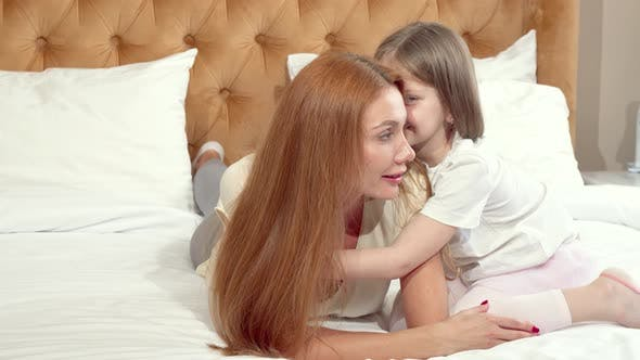 Cover Image for Cute Little Girl Enjoying Resting at Home with Her Mother