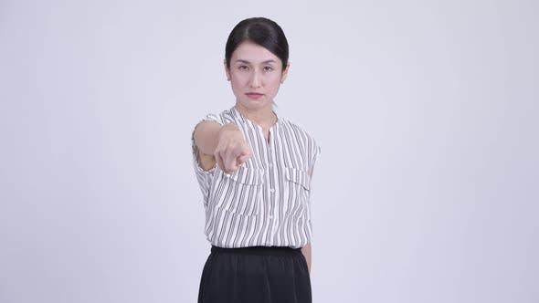 Thumbnail for Serious Asian Businesswoman Pointing at Camera