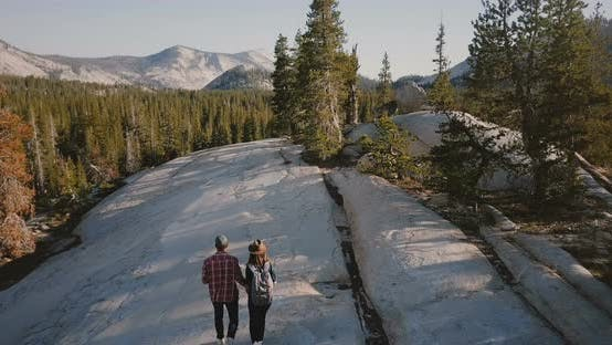 Thumbnail for Aerial Tracking Shot of Young Romantic Couple Hugging, Hiking Together on Amazing White Rock