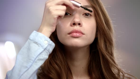 Thumbnail for Woman Applying Mascara on Eyelashes. Girl Applying Beauty Make Up