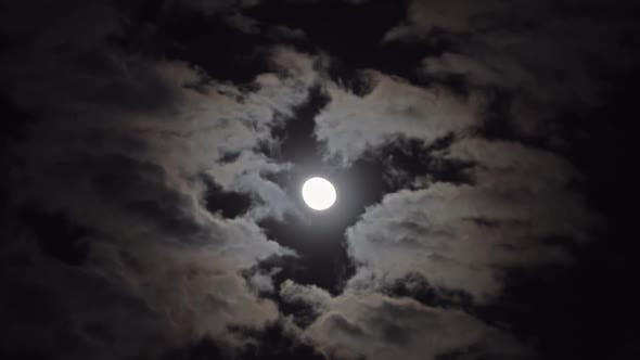Thumbnail for Full Moon Moving Between Clouds, Timelapse