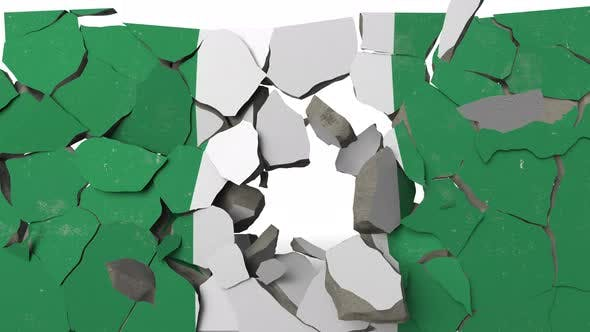Destroying Wall with Painted Flag of Nigeria