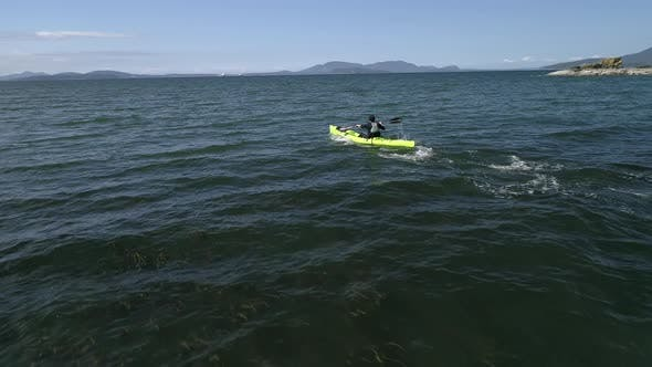 Thumbnail for Drone Flying Low By Man Paddling Fast In Ocean Kayak
