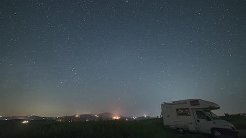 Time lapse: night sky landscape in Orcia Valley, Tuscany, Italy. The Milky Way galaxy and stars over