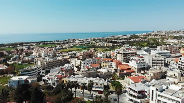 Thumbnail for Aerial shot of paphos city in cyprus with buildings and business centers with sea in background.