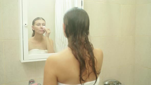 Funny Happy Attractive Woman Apply Skincare Cream On Face