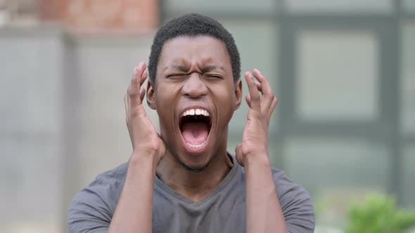 Portrait of Angry Young African Man Shouting, Screaming