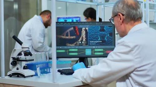Scientist in Lab Coat Working at a Computer in Laboratory